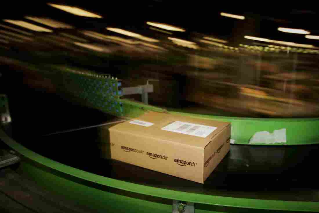 An Amazon.co.uk parcel passes along a conveyor belt at a facility in Milton Keynes, England.