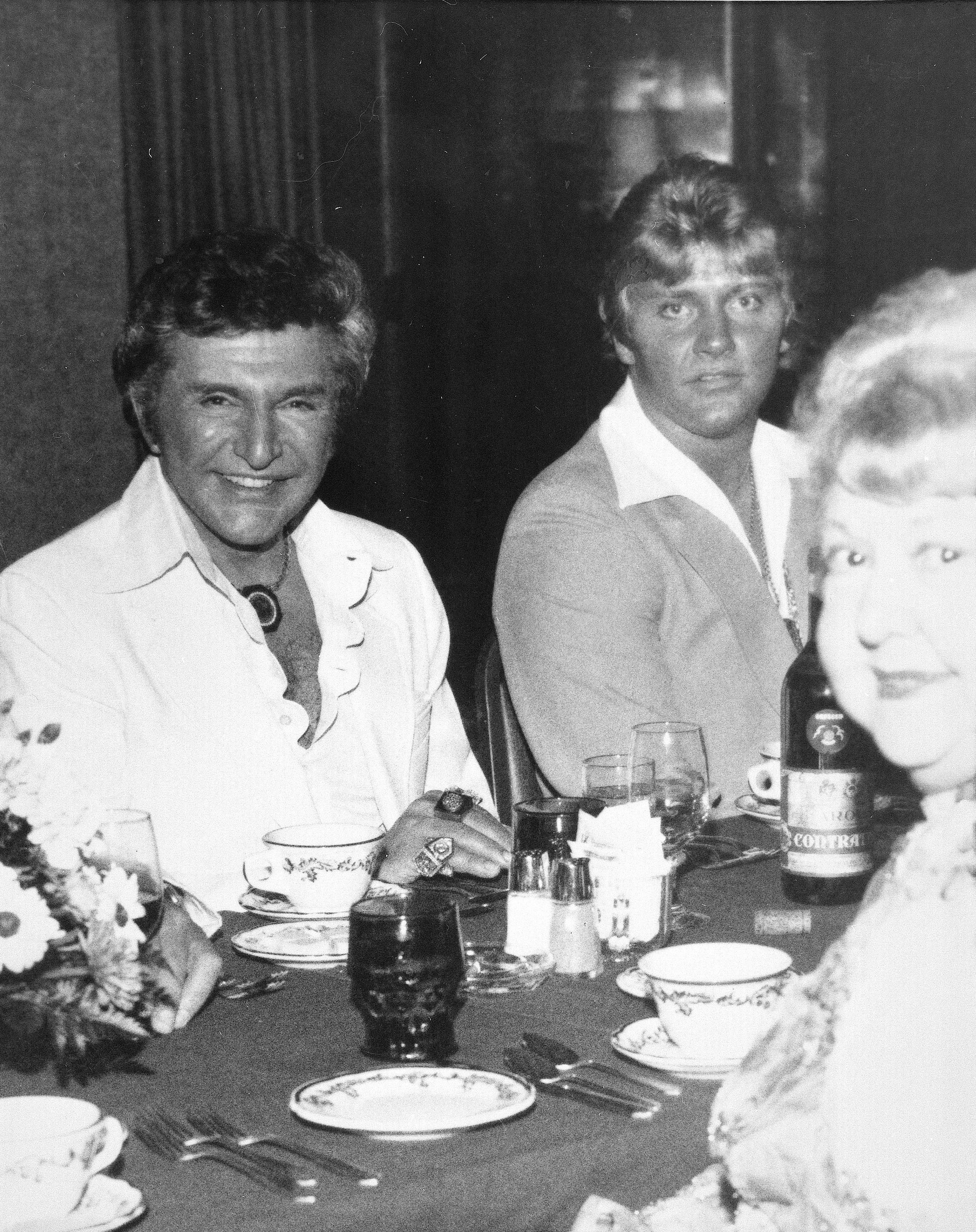 Entertainer Liberace (left), with Scott Thorson, often described during their time together as his bodyguard, chauffeur and confidant, at a Boston-area restaurant in 1981.