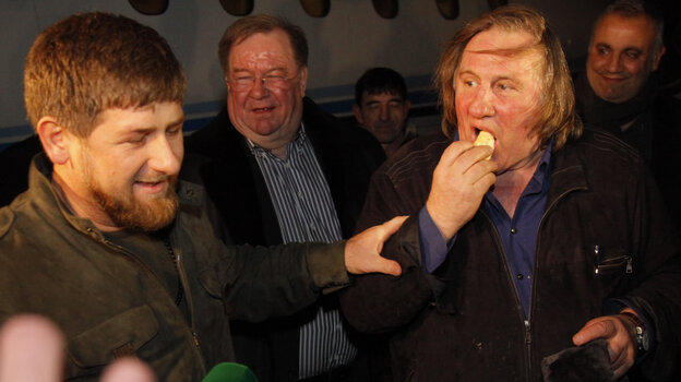 French actor Gerard Depardieu (right) chats with Chechen leader Ramzan Kadyrov shortly after his arrival in Chechnya's capital, Grozny, on Feb. 24.