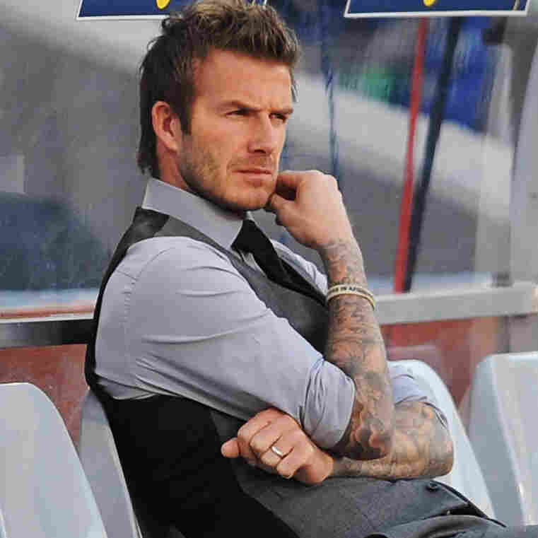 David Beckham, seen here on the sidelines of a 2010 World Cup match, has announced that he is retiring. The 38-year-old midfielder appeared in 115 matches for England's team and won titles in four different national leagues.