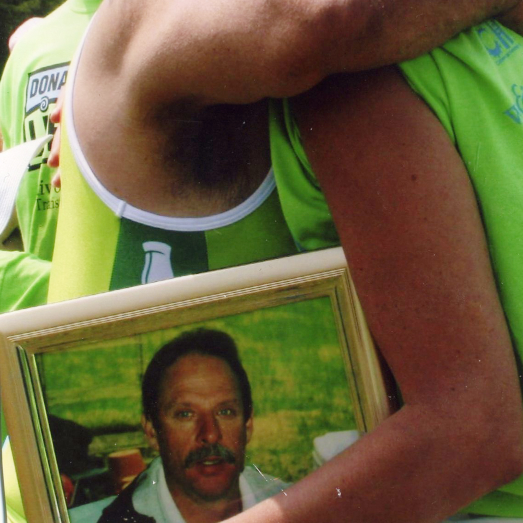 Dorothy met Rick at the finish line of his first triathlon, holding a photo of her late husband, Marty.