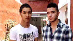 Tarik al-Nakib (left) says Gaza Strip police officers picked him up on the street and forced him to get his hair cut recently. He's growing it out again in a style similar to that of his friend Mohammad Abu Ramadan.
