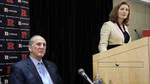 Rutgers athletics director Julie Hermann takes a question as university President Robert Barchi looks on Wednesday. Hermann' hire comes a month after the school fired its basketball coach over a video of abusive practices.