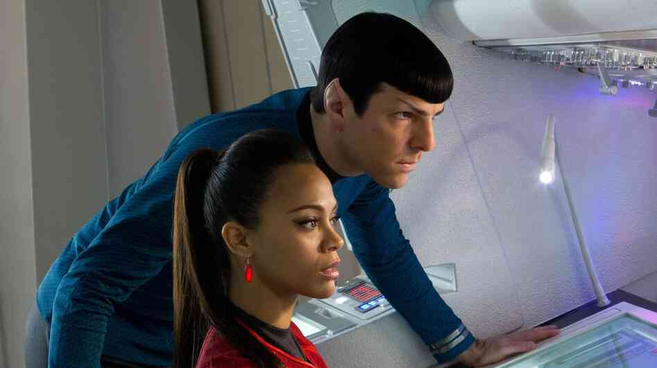 Zoe Saldana is Uhura and Zachary Quinto is Spock in the new J.J. Abrams-directed Star Trek: Into Darkness, the 12th installment in the franchise.