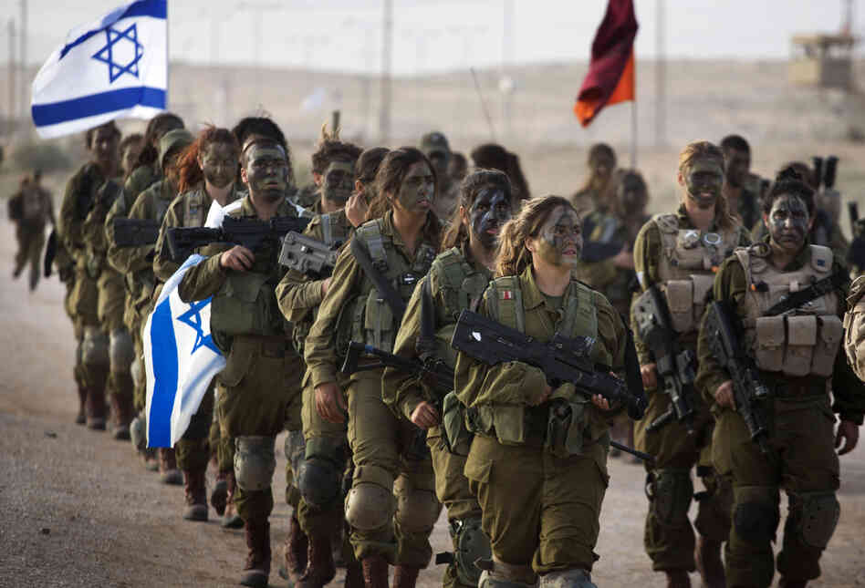 Soldiers of Israel's 33rd Caracal Battalion take part in a graduation march in the northern part of the southern Israeli Negev desert on March 13. The Caracal was formed in 2004 with the chief purpose of giving women a chance to serve in a true combat role.