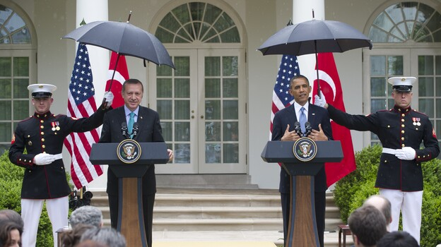 Rain fell Thursday during part of President Obama's joint news conference with Turkish Prime Minister Recep Tayyip  Erdogan in the Rose Garden of the White House. (AFP/Getty Images)