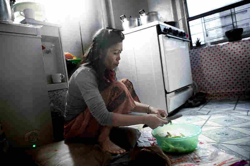 Thon Khoun, 47, cooks in her kitchen in the Bronx, N.Y. Khoun immigrated as a refugee in 1985 and is a single mother of four. Like many Cambodian refugees, she speaks no English and her children are incapable of speaking Khmer.
