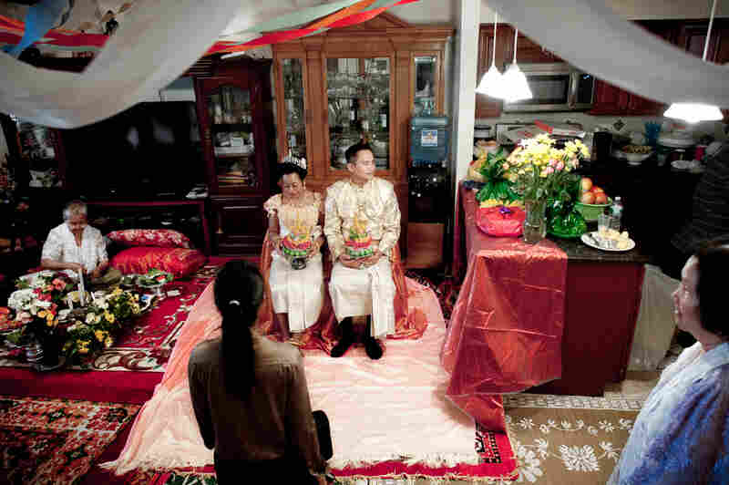 Wedding of Molly Sopuok, 38, and Todd Prom, 38, in a Cambodian home in the Bronx, N.Y.
