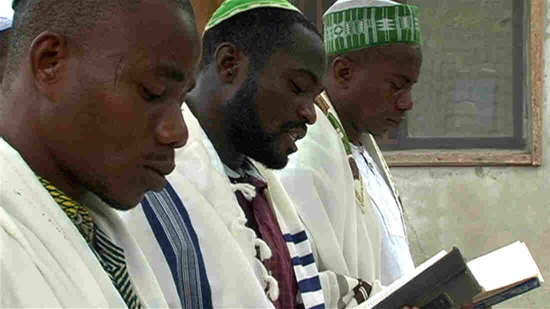 Shmuel Tikvah (center) leads morning prayers among his congregation in the southern delta city of Port Harcourt, Nigeria.
