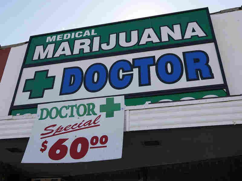 A sign outside a medical marijuana evaluation clinic in Los Angeles.