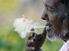 A man smokes a cigarette as he takes a break at a fruit market in Hyderabad, India. Smoking tobacco is eight times more prevalent among Indian men than women.