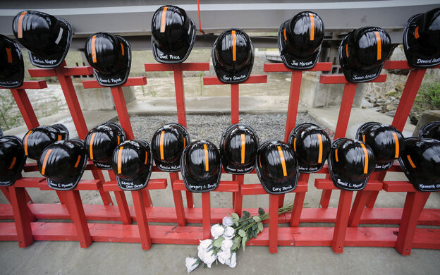 A memorial at the entrance to Massey Energy's Upper Big Branch coal mine represents the 29 coal miners who were killed in an explosion in 2010.
