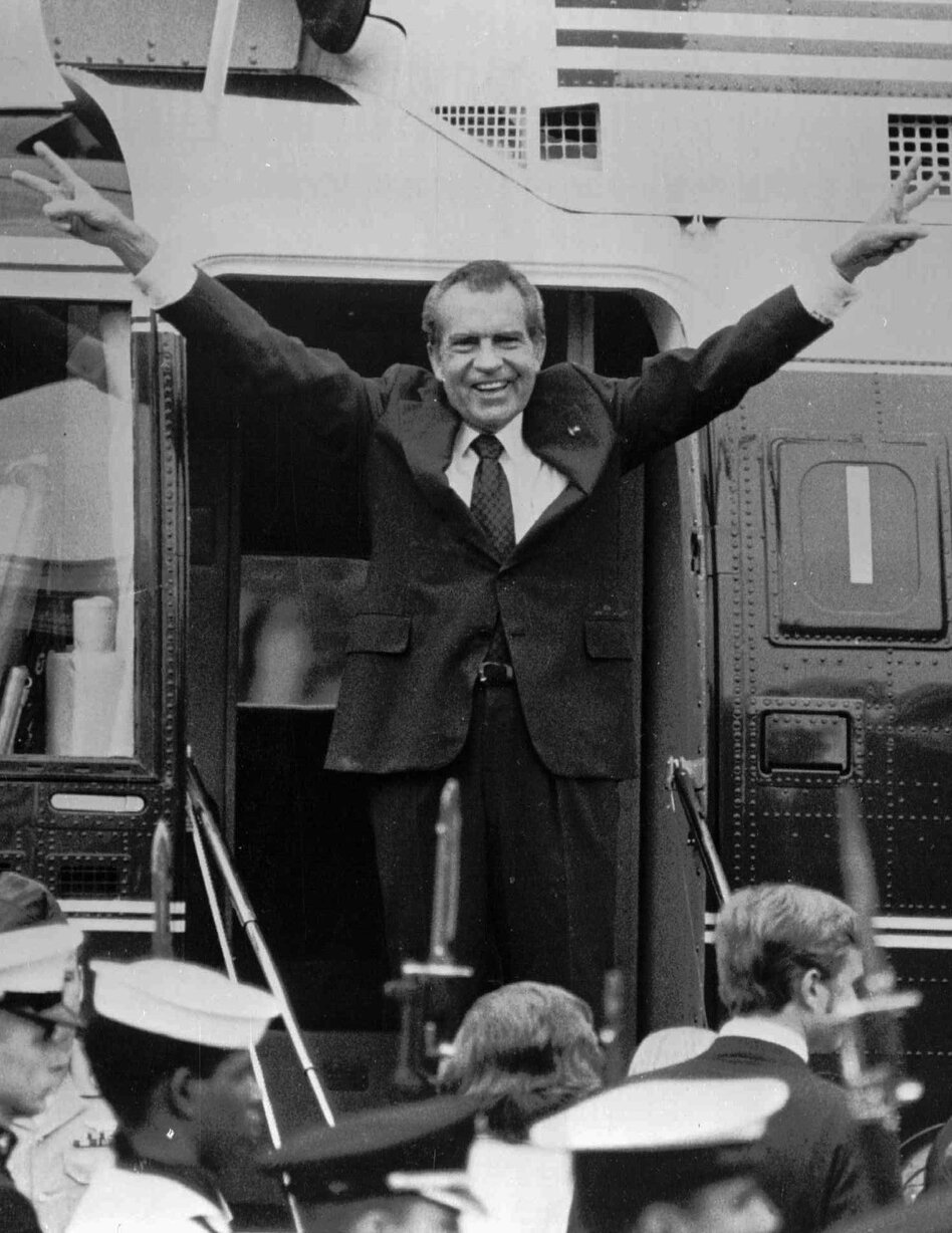 Richard Nixon says goodbye to members of his staff outside the White House as he boards a helicopter after resigning the presidency on Aug. 9, 1974.