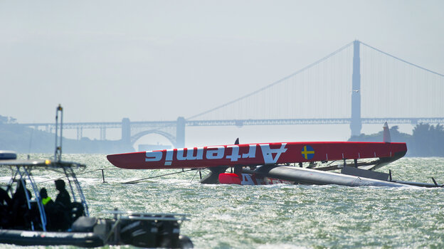 The Artemis Racing AC72 catamaran lies capsized after a training sail in San Francisco Bay on May 9.