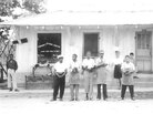 Frank Morris (in the apron and visor) stands in front of his shoe shop in Ferriday, La., in the 1950s. He was killed when his shop burned down in 1964.