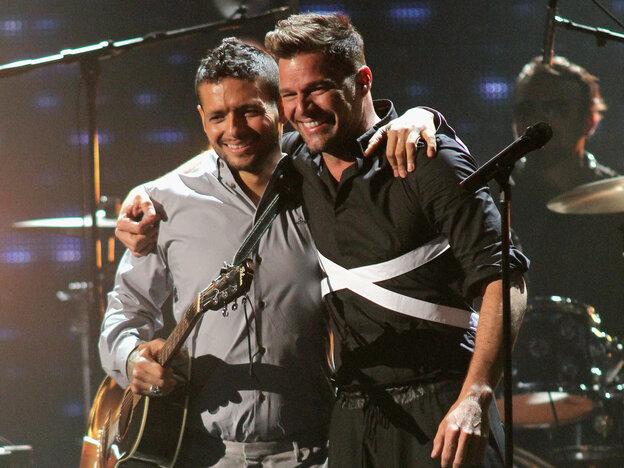 Former bandmates Draco Rosa and Ricky Martin, seen here on stage at Univision's 2013 Premio Lo Nuestro awards celebration, reunite on Rosa's new album, Vida.