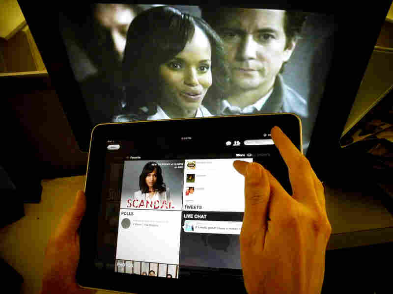 Kerry Washington from ABC's Scandal is shown on a TV monitor as an iPad displays the show page.