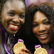 Serena (right) and Venus Williams pose with their gold medals during the London 2012 Olympic Games.