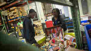 TD Bank volunteers sort donated food into barrels at the Manna Food Center in Gaithersburg in Montgomery County, Md. Poverty in