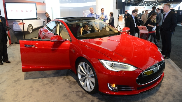 The Tesla Model S, Motor Trend Car of the Year, is introduced at the 2013 North American International Auto Show, in Detroit in January. Tesla's attempts to sell its cars without going through dealerships is meeting resistance. (AFP/Getty Images)