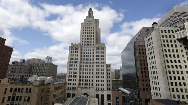 """The iconic Industrial Trust Tower, knows as the """"Superman building,"""" stands in downtown Providence, R.I. The art deco-style skyscraper, the tallest in the state, lost its last tenant when the bank's lease expired in April. (AP)"""