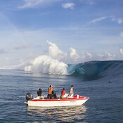 Boats line up to photograph this year's Teahupoo swell in Tahiti.