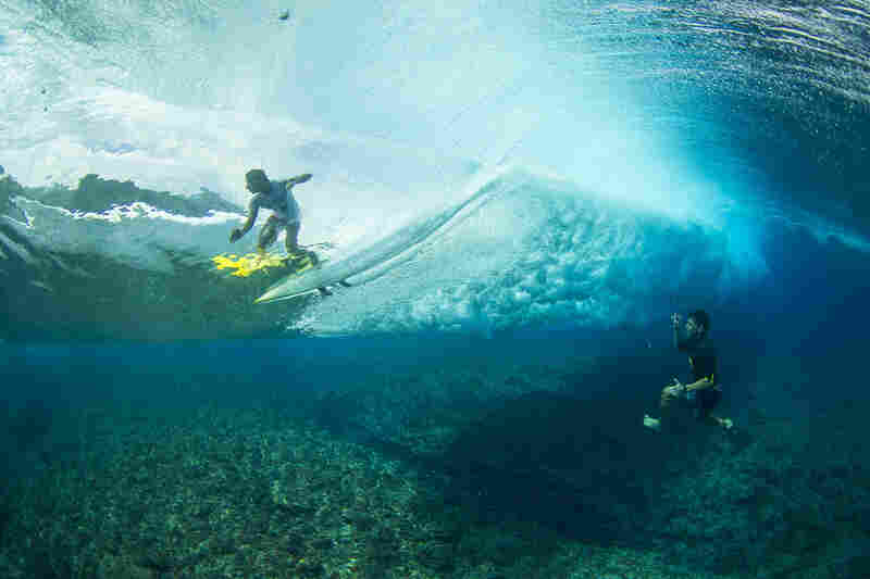 Hawaiian surfer Kamalei Alexander captures images of a friend at Teahupoo this year.