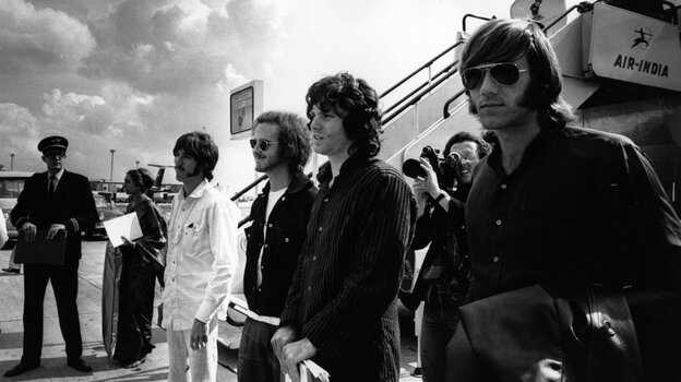 Ray Manzarek (far right) stands with fellow members of The Doors Jim Morrison (from right), Robby