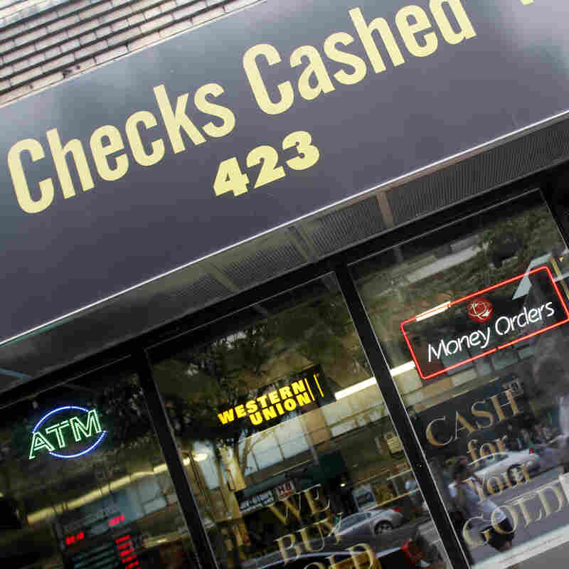 Millions of people who rely on check-cashing stores, like this one in New York City, could run into trouble buying health insurance.