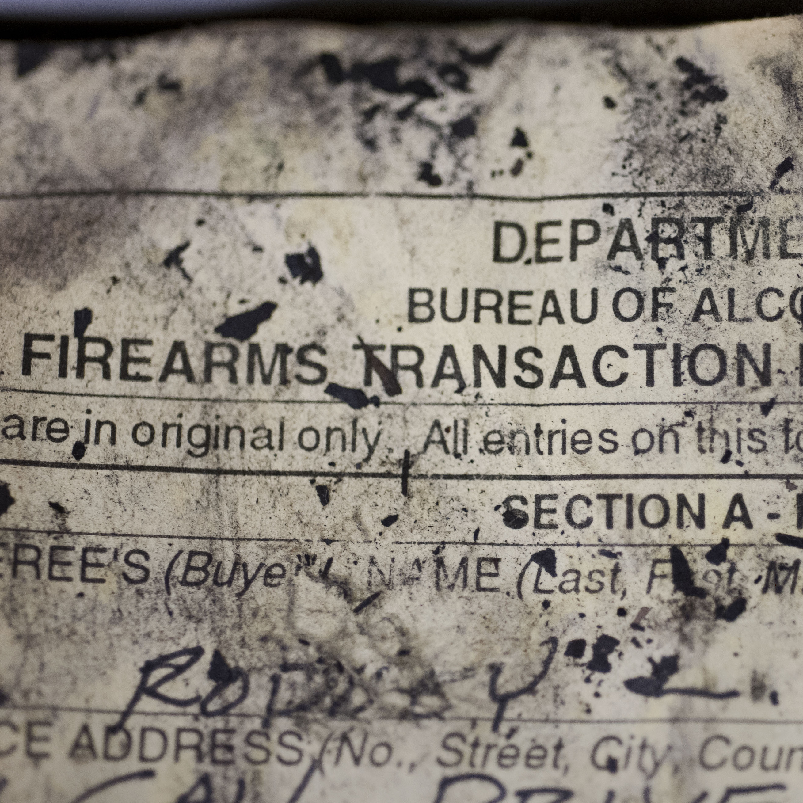 The Bureau of Alcohol, Tobacco, Firearms and Explosives (ATF) processes firearm transaction documents from firearms dealers no longer in business, no matter the condition of the documents, such as this fire and water damaged ledger at their National Trace Center in Martinsburg, W.Va.