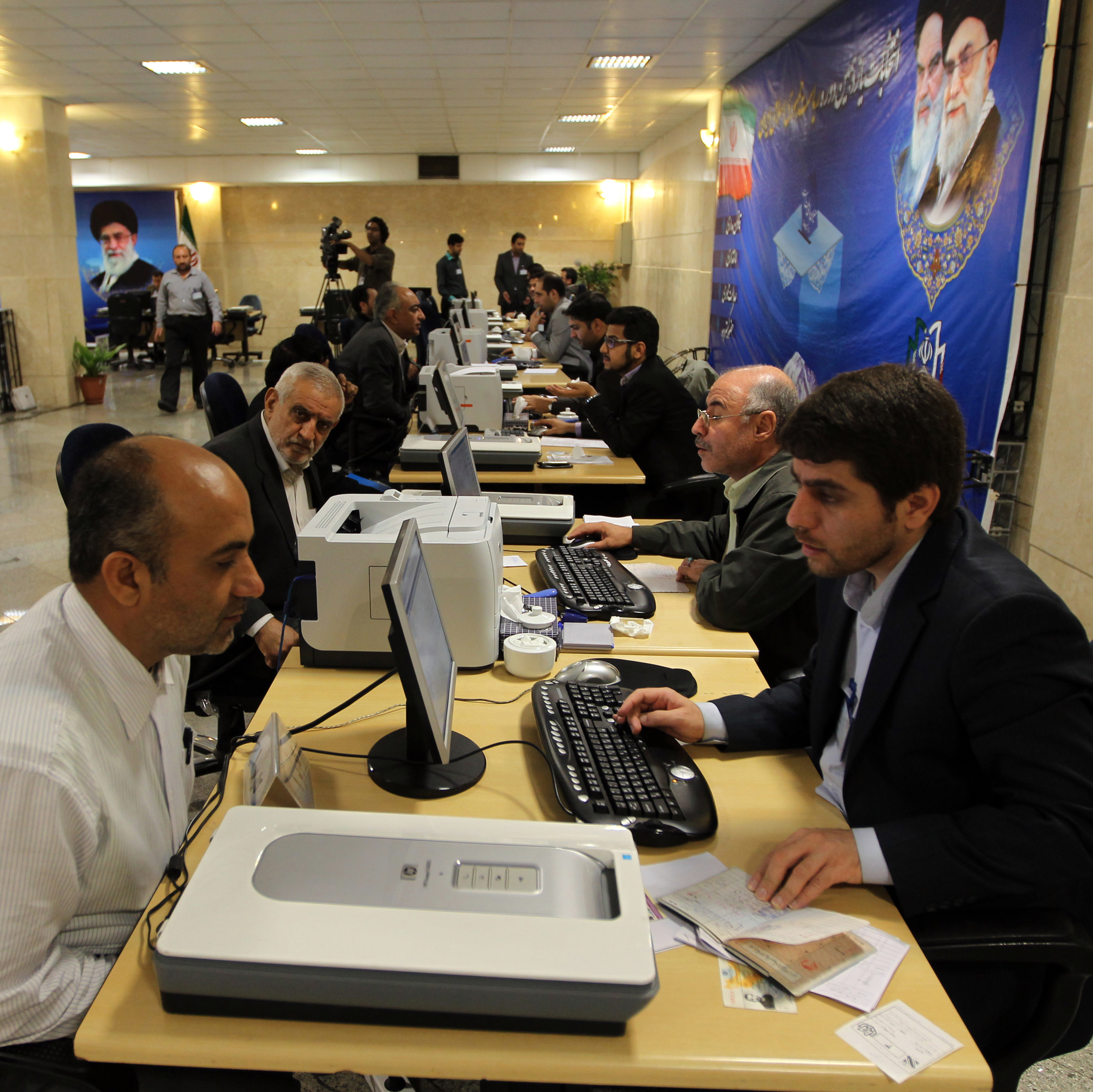 Iranian men register their candidacy for the June presidential election at the Interior Ministry in Tehran earlier this month. Some 700 candidates have registered, but most will be disqualified.