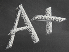 Big fat A+ written in chalk on a blackboard.