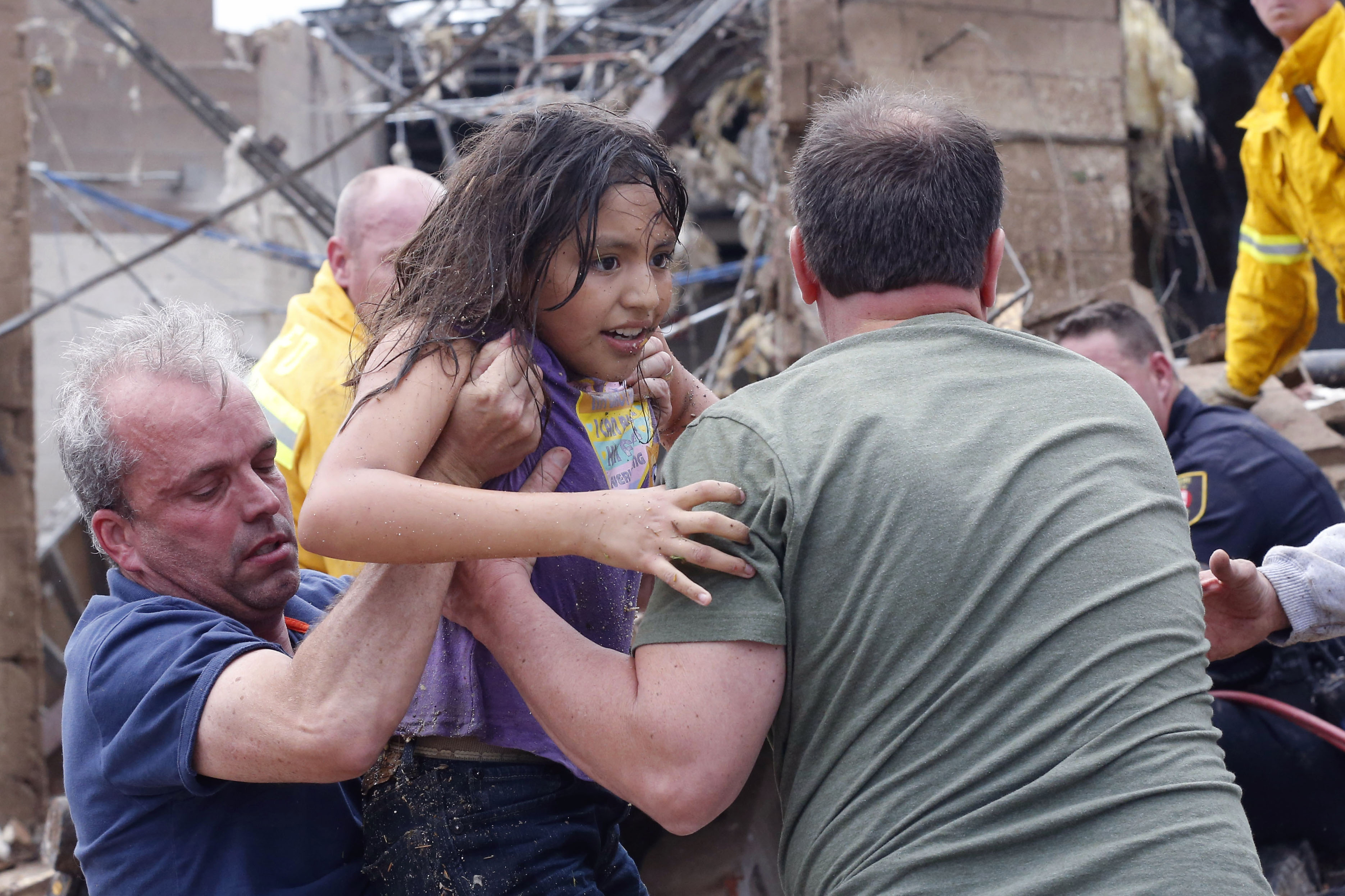 A child is pulled from the rubble of Plaza Towers Elementary School in Moore on Monday after a tornado up to a mile wide roared through the Oklahoma City suburb.