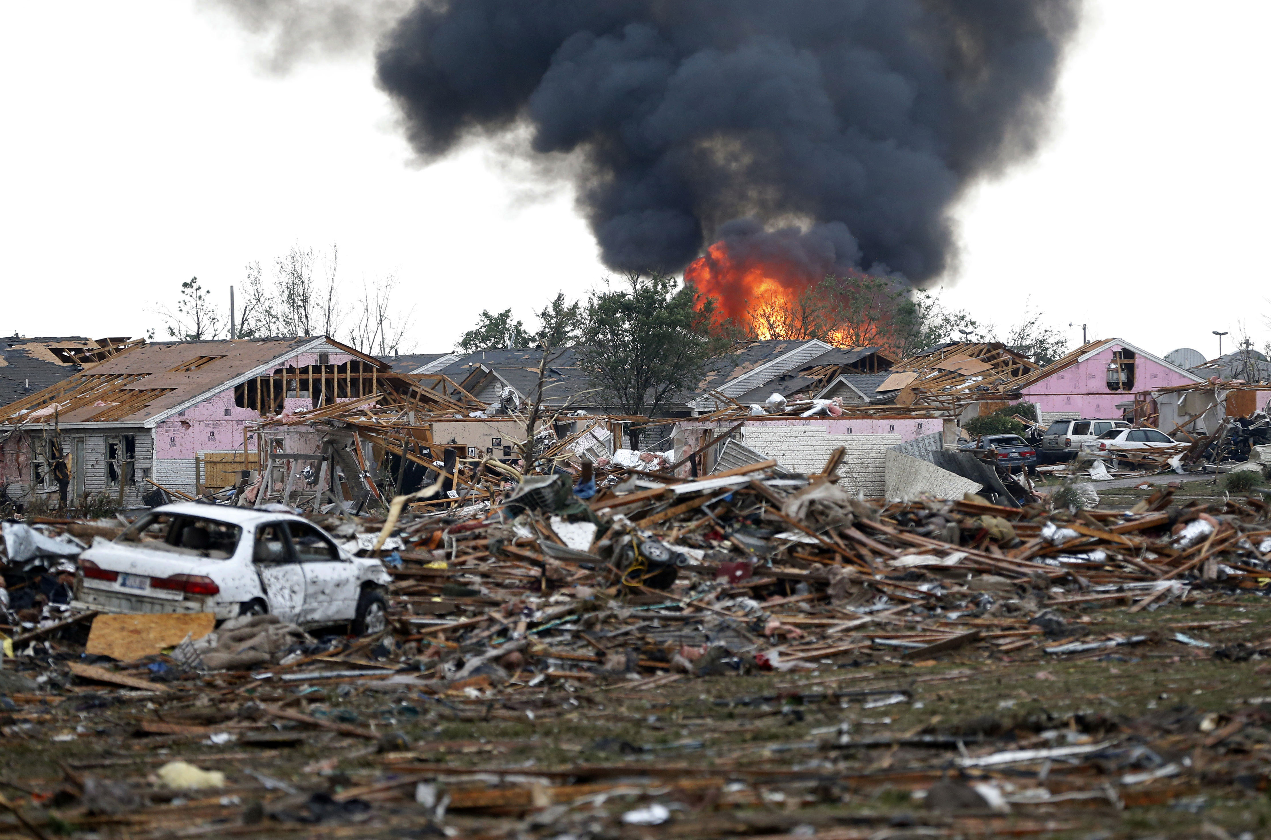 A fire burns in Moore after the twister hit with a rating of at least EF4, according to the National Weather Service. The rating was upgraded Tuesday to EF5.