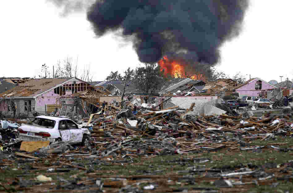 A fire burns in Moore after the twister hit with a rating of at least EF4, according to the National Weather Service.