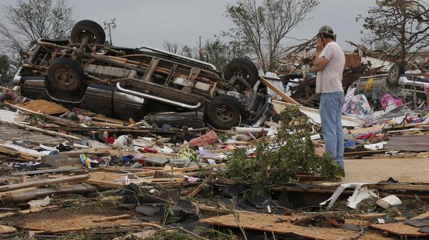 John Warner surveys the damage near a friend's mobile home in the Steelman Estates Mobile Home Park, destroyed in Sunday's tornado, near Shawnee, Okla., on Monday. (AP)