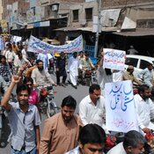Protesters march against the prolonged power outages in Faisalabad, Pakistan, on April 11. The country faces power outages of more than 18 hours a day in some parts of the country.