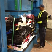 Worker Charles Lee sorts through clothes at Mac Recycling near Baltimore. Textile recycling is a huge international business, and a small facility like Mac ships about 80 tons of clothes each week to buyers around the world.