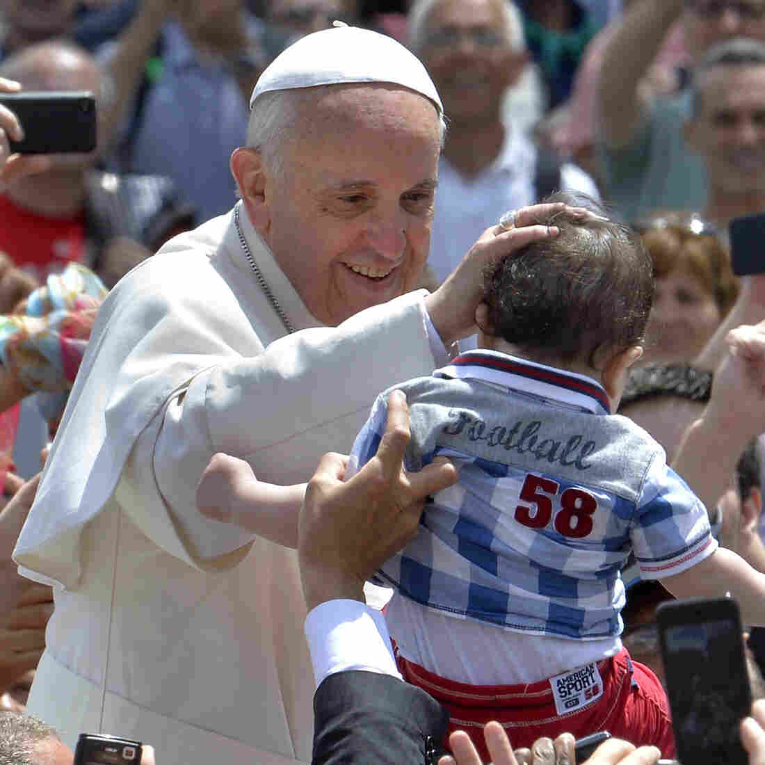Pope Francis blesses a child Sunday after the Holy Mass at St. Peter's Square, at the Vatican.