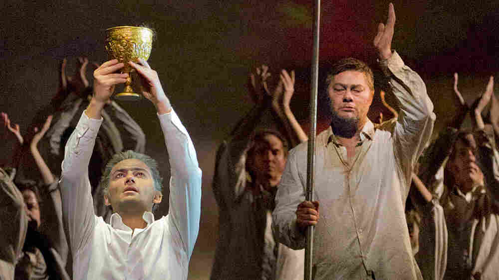 Parsifal (Jonas Kaufmann) lifts the Holy Grail as Gurnemanz (Rene Pape) looks on, in a recent Metropolitan Opera production of Wagner's final opera, Parsifal.