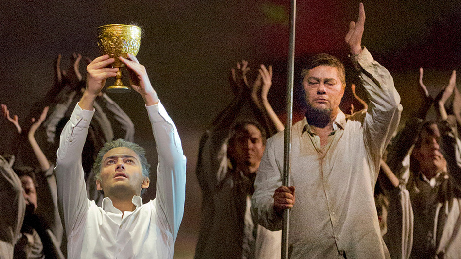 Parsifal (Jonas Kaufmann) lifts the Holy Grail as Gurnemanz (Rene Pape) looks on, in a recent Metropolitan Opera production of Wagner's final opera, Parsifal. (Metropolitan Opera)