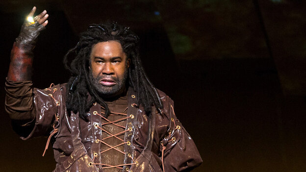 Eric Owens plays the greedy dwarf Alberich, displaying his golden ring, in Wagner's Das Rheingold.