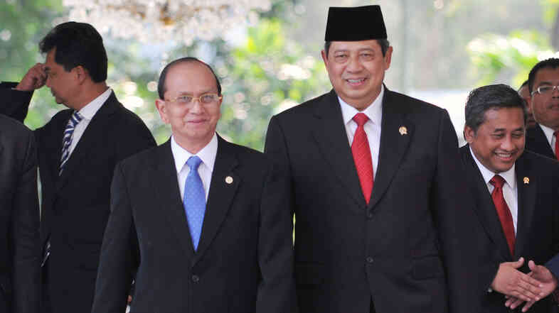 Indonesian President Susilo Bambang Yudhoyono (right) walks with Myanmar's then-prime minister, Gen. Thein Sein, at the Presidential Palace in Jakarta on March 16, 2009. Both men are former military officers, leading their Sou