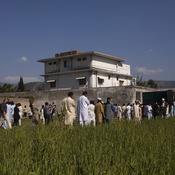 Pakistanis along with international and local media gather outside Osama Bin Laden's compound, a day after the successful raid by U.S. Special Forces.