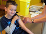 Luke Tanner, 7, gets vaccinated for measles at a clinic near Swansea, Wales, in April. Wales is at the center of a measles outbreak that has caused one death.