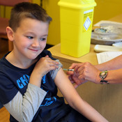 Luke Tanner, 7, gets vaccinated for measles at a clinic near Swansea, Wales, on April 19. Wales is at the center of a measles outbreak that has caused one death.