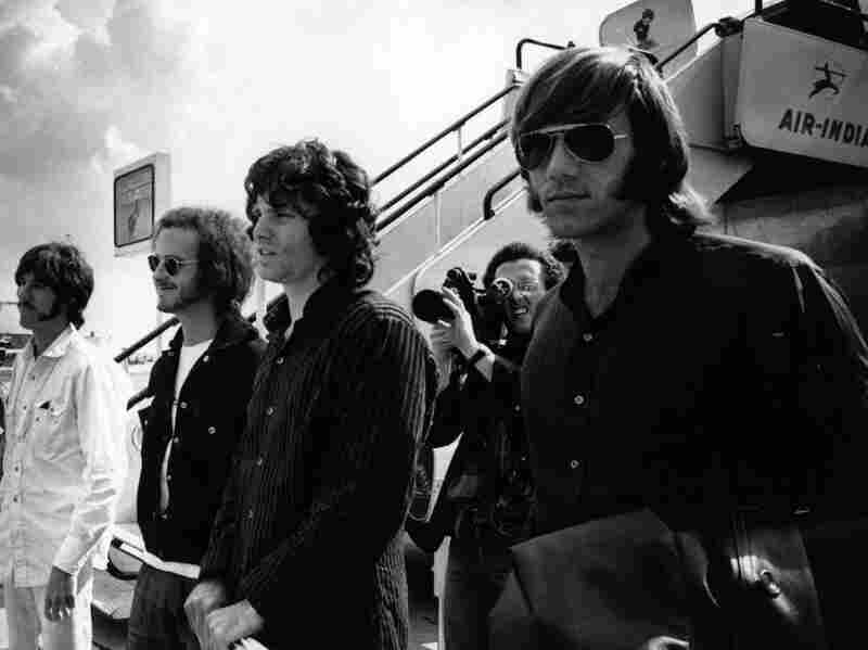The Doors at London Airport in 1968. Left to right: John Densmore, Robby Krieger, Jim Morrison and Ray Manzarek. Manzarek died May 20 of bile-duct cancer.