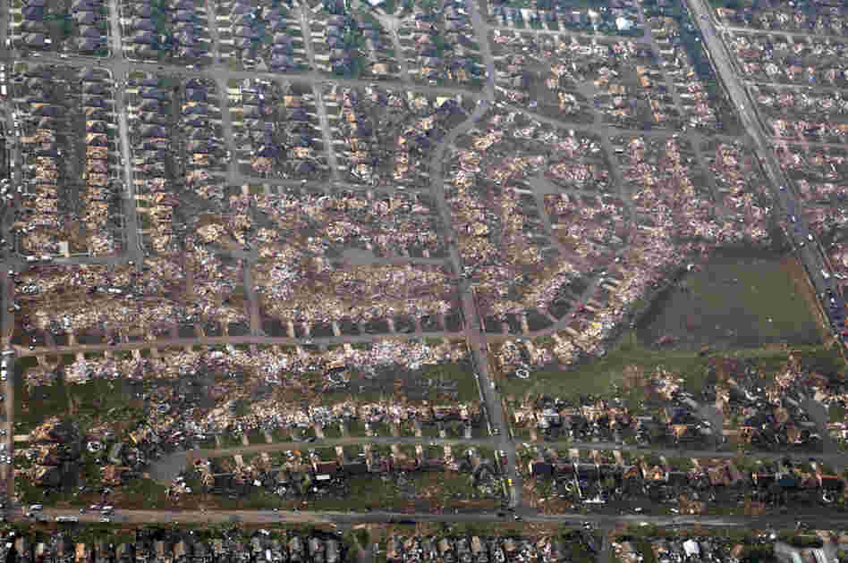 An aerial photo shows the remains of homes hit by the tornado in Moore on Monday. Forecasters warned that more severe weather is possible in the area Tuesday.