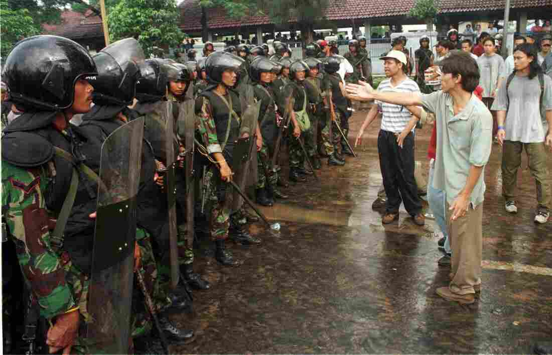Police and students stand off at Trisakti University in West Jakarta, Indonesia, on May 8, 1998, before scuffles erupted. Student protests against President Suharto that ignited throughout Indonesia ultimately ended the 30-year rule of the military leader.
