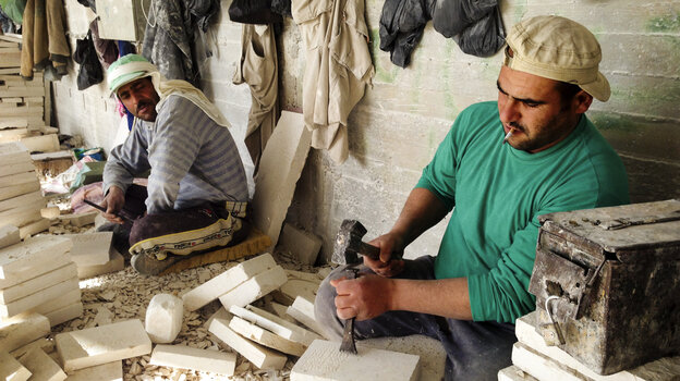A worker chips away at Jerusalem stone, likely destined for a building facade somewhere in the world. Stone and marble is a big business in Palestinian towns near Bethlehem. Quarries are in Israeli-controlled areas, and access can be a challenge.